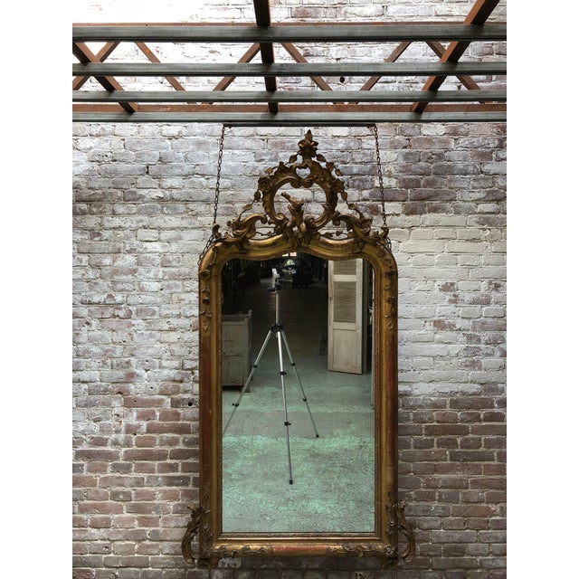 19th century mirror, gold leaf gilded with its original mirror-glass, Provenance France This 19th Century Mirror is...