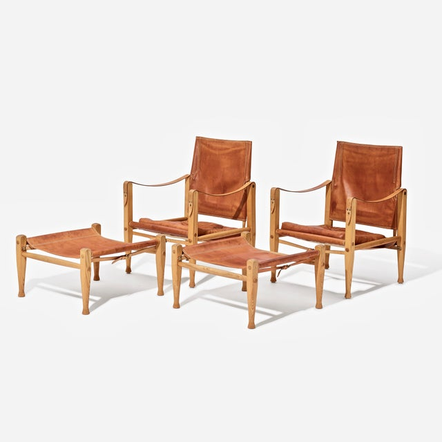 A wonderful and rare pair of Kaare Klint Safari Chairs and Ottomans, produced by Rud Rasmussen, Denmark, 1960s. Ash frames...