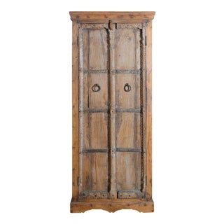 Mid 19th Century Indian Armoire with Hand-Carved Motifs and Metal Stretchers For Sale