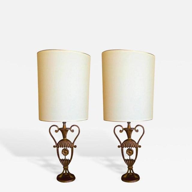 MAISON BAGUÈS Rare air of gold leaf cast iron charming little pair of lamp.