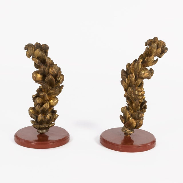 Pair of 18th century carved giltwood architectural elements depicting fruit, flowers, thistle and berries; Italian circa...