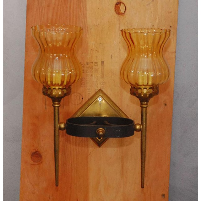 Diamond shaped brass backing with an oval iron band design holding two lights. Topaz colored glass shades give these...