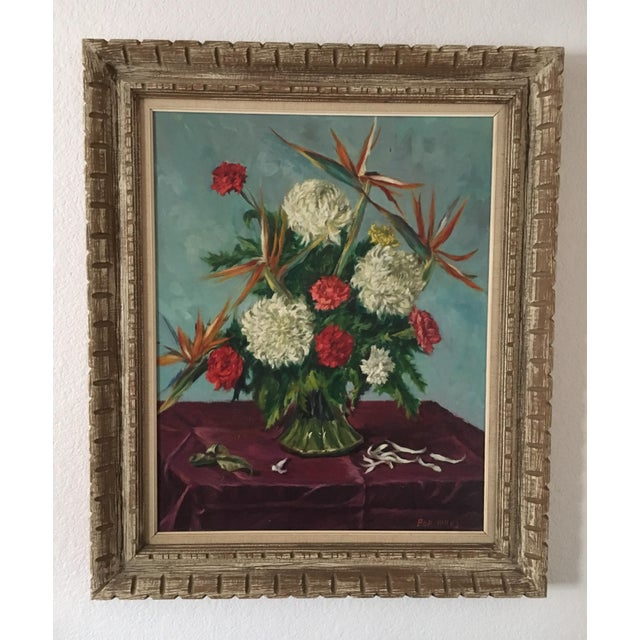 This original oil painting by Ben Wilks (1914-2001) is a dramatic flower arrangement of red carnations, white peonies and...