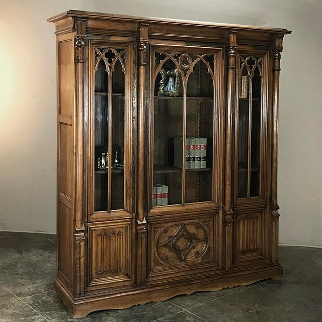 19th Century Gothic Walnut Triple Bookcase is a stunning example of French craftsmanship in what is considered the oldest...