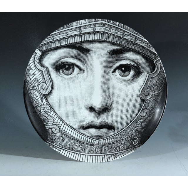 Fornasetti Tema E Variazioni Plate, Number 95, The iconic image of Lina Cavalieri, Atelier Fornasetti. A variation of...