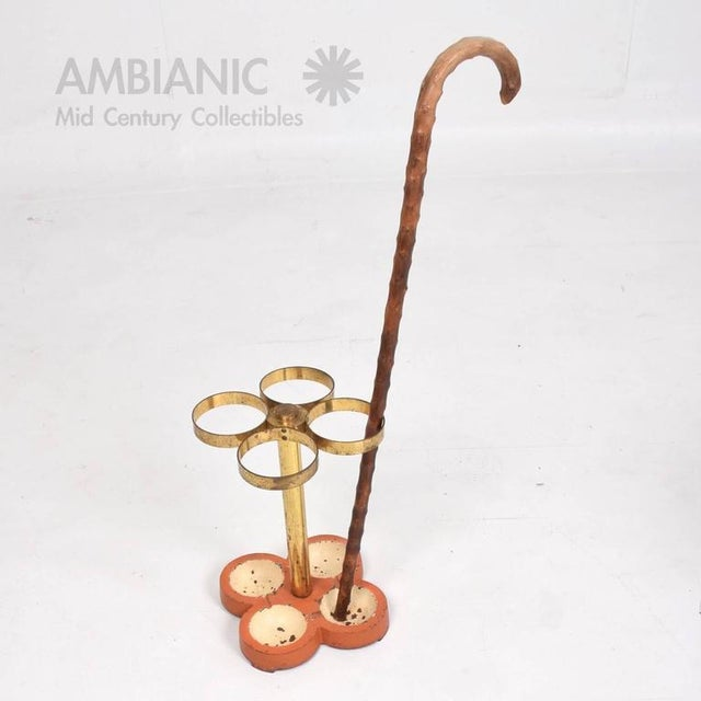 For your consideration a vintage Mid-Century Modern umbrella or cane stand. Cast iron base with original paint and brass...
