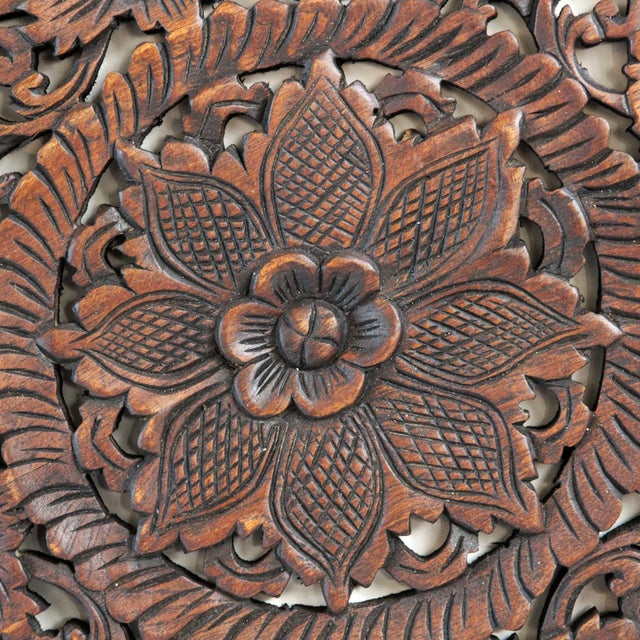 Hand carved teak medallion panel are a traditionally made by Burmese artisans with intricate floral designs and dark wax...