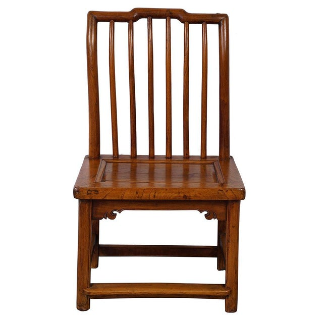 This Chinese antique Chair is made from solid elm wood with natural  finished. It features - Antique Chinese Carved Low Chair Chairish