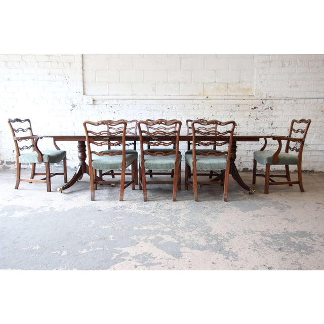 Offering a beautiful formal Drexel Heritage banded mahogany double pedestal dining table with eight chairs. The table...