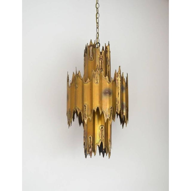 Striking midcentury Brutalist movement handcrafted torch cut patinated brass two-tier chandelier by Tom Greene, circa...