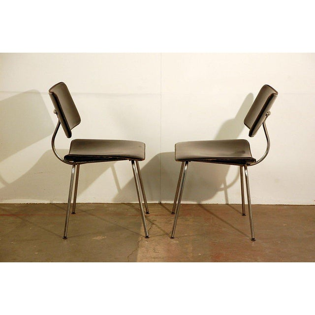 Pair of slender Italian stitched leather lounge chairs. Two more available, so four total for $3,600.