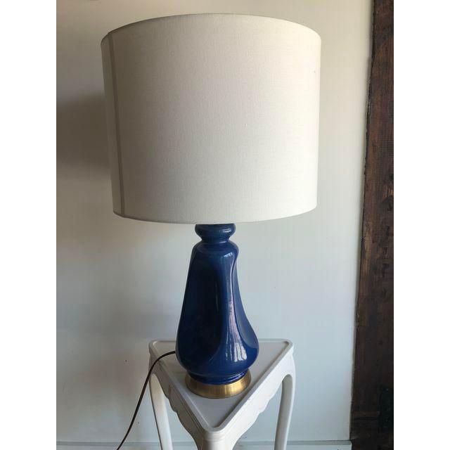 "Blue ceramic base by Aerin Lauder Kapila Table Lamp ITEM: ARN3614 Height: 28.75"" Width: 17"" Base: 6.25"" Round Shade..."