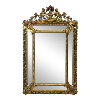 French Carved Giltwood Putti Motif Cushioned Mirror, Paris, 1900 For Sale