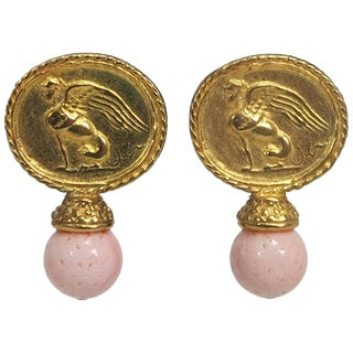 Jaded Faux Gold Winged Sphinx & Angel Skin Coral Ball Clip Back Earrings For Sale