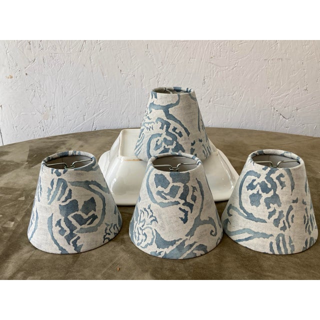A set of 4 chandelier shades handmade with Fortuny's iconic printed cotton. Measurements top 2.5 side 4 bottom 5