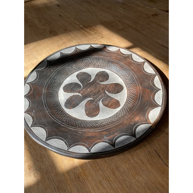 Wonderful abstract Terracotta plate with a black glaze made in the traditional majolica method from Mexico. This is a...