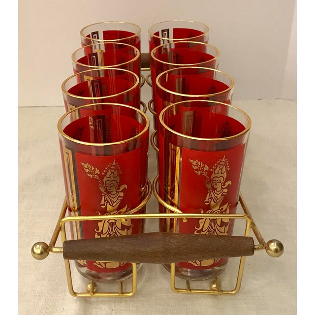 Beautiful red and gold Culver Glasses with Thai dancers. Includes a brass and wood caddy. Nice set! Some where on the...