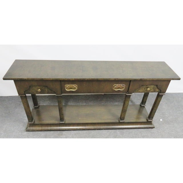 Hollywood regency mid century modern console table made by Tomlinson. Burlwood with 3 drawers and large brass hardware