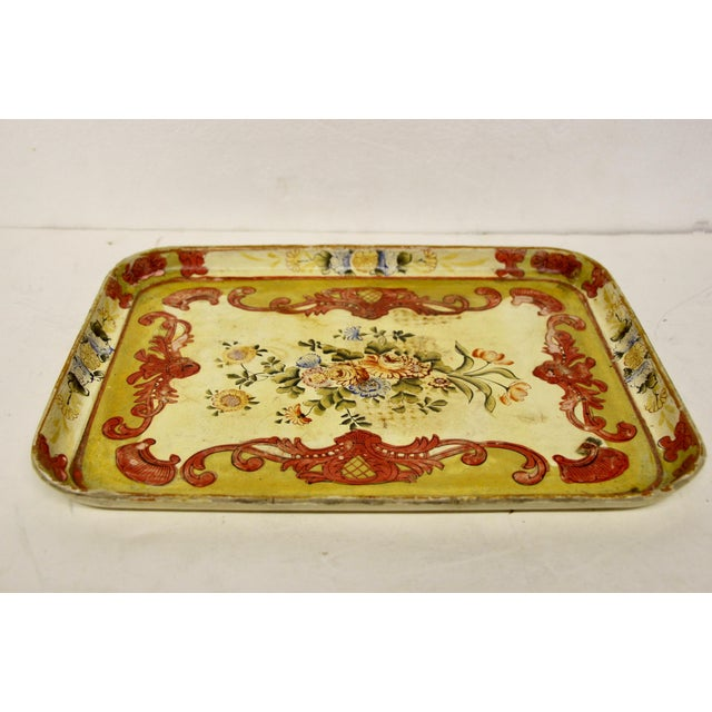 Hand-painted papier mache tray Circa 1940's. Distress and age wear throughout. The finish is water and alcohol proof....