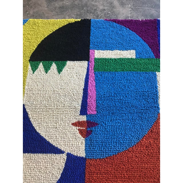 Limited edition custom designed 100% wool multi colored pile abstract rug in the female form. Made in India. Can also...