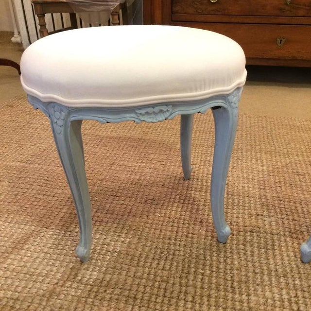 Two lovely stools or small ottomans having grey blue painted bases with pretty carved shell decoration and cabriole legs,...