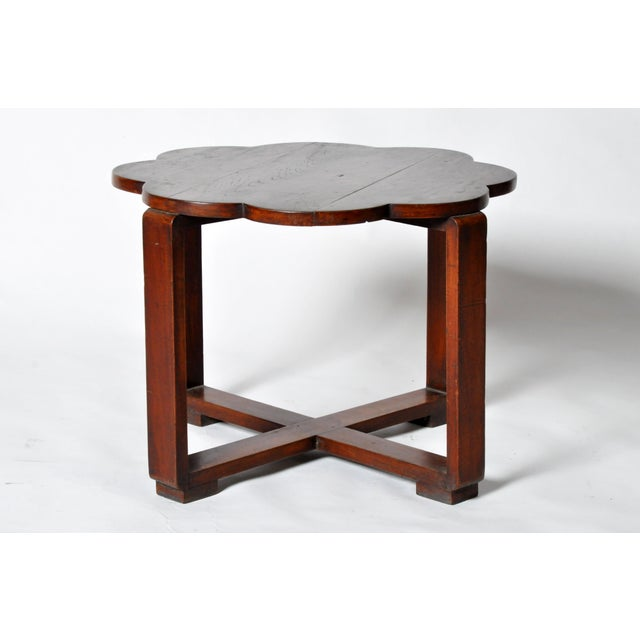 This Art Deco low table is from Myanmar and is made from teak wood. It is a strong and sturdy table that can function as a...