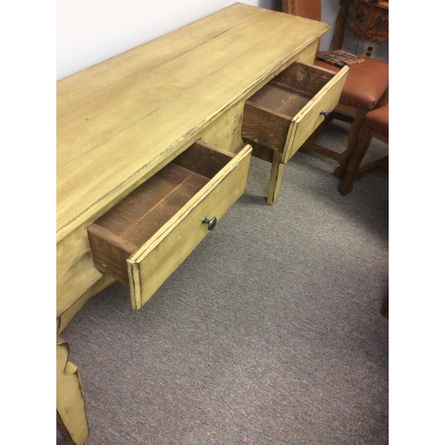 This buffet is in fantastic condition. It is a shabby chic-ed yellow. I believe the wood is a clear pine. I has 2 drawers....