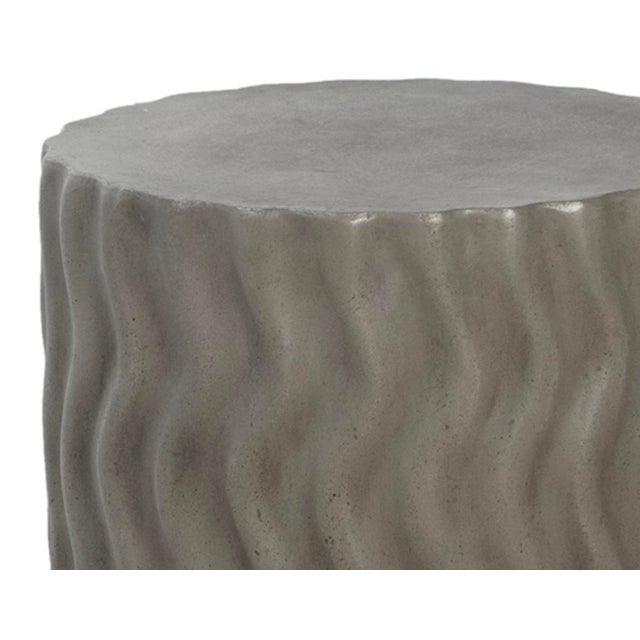 Outdoor lightweight round cement side table with raised zig-zag wave pattern on sides. Smooth finish. Each may have...