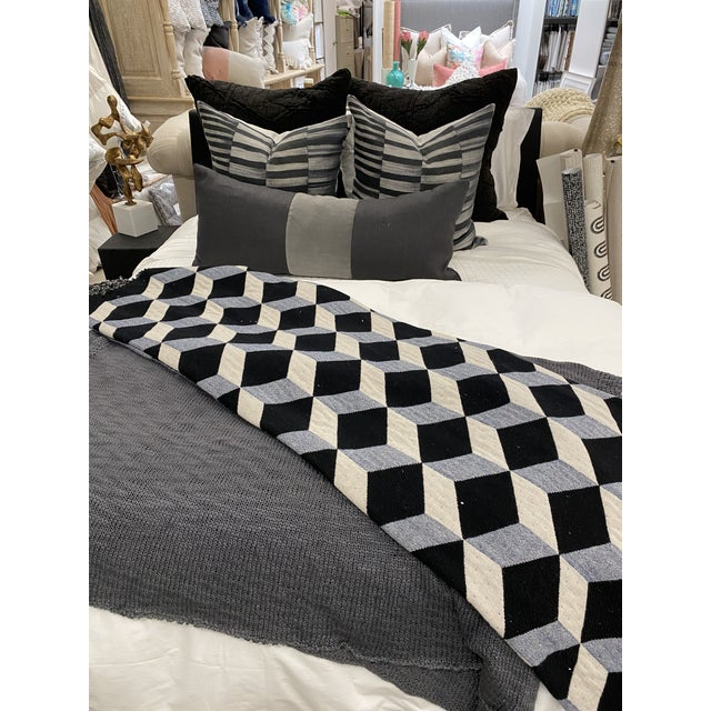 The geometric pattern on the this wool & cashmere throw is the perfect neutral-toned accent for a monochromatic black and...