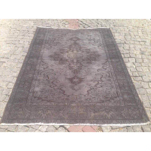 A vintage Turkish Oushak rug with soft fading and an evenly worn aesthetic. There are many years of enjoyment to come with...