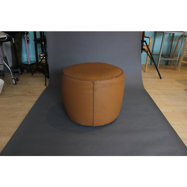 Beautiful Leather pouf with Large baseball stitched detailing. Pouf collection with structure in multi-layered poplar....