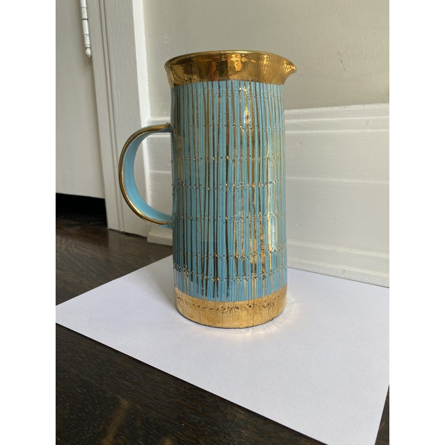 Gorgeous turquoise and gold Mid Century Modern Italian pitcher/vase. it very rare and very pretty.