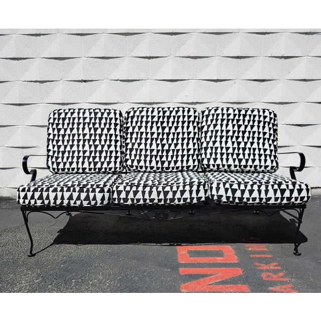Classic mid century painted aluminum sofa from Russel Woodard, updated with new cushions and graphic black and white...