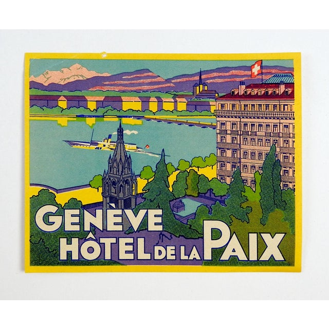 Circa 1920's luggage label or tag from the Geneve Hotel de la Paix, great color and graphics. Unused, tiny edge pinhole.