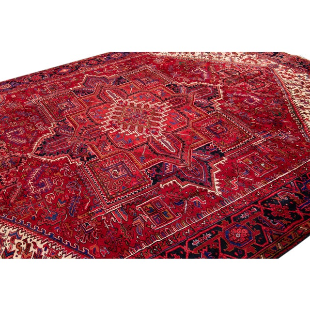 Vintage hand-knotted Persian Heriz rug with a medallion motif. This piece has great detailing and a beautiful design, it...