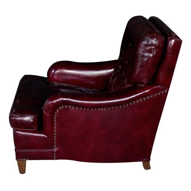 Perfect for the den or library, the sumptuous club chair with tufted back and rolled arms; the matching ottoman with semi-...