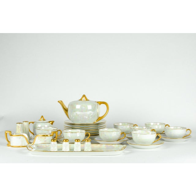 German vintage porcelain lusterware luncheon service. All together 31 piece set. Each piece is in excellent condition. Tea...