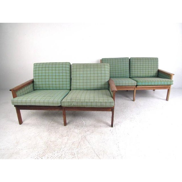 This stunning pair of vintage Danish teak settees make a beautiful Mid-Century addition to seating at home, office, or...