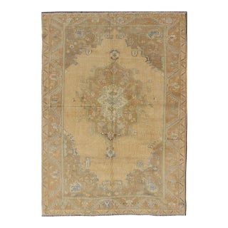 Faded Vintage Turkish Oushak Rug With Layered Medallion For Sale