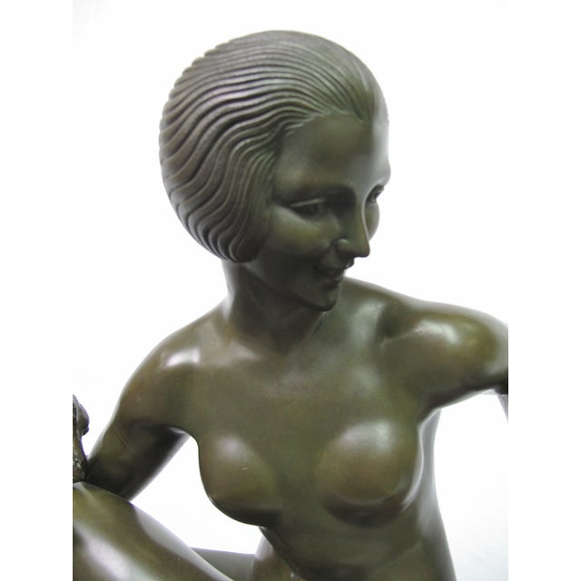 Art Deco bronze sculpture by Maurice Guiraud-Riviere (French, 1881-1947). A scarce untitled work often called woman with...