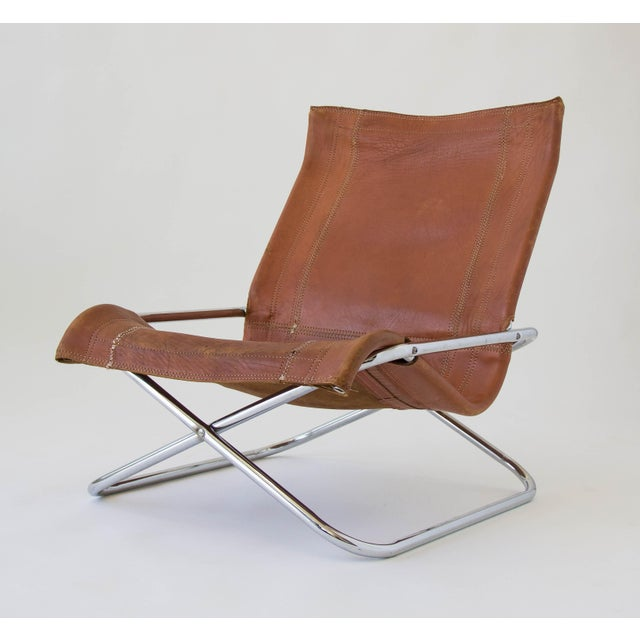 A Japanese folding lounge chair by Suekichi Uchida from the 1970s. Design employs the same folding mechanism as a...