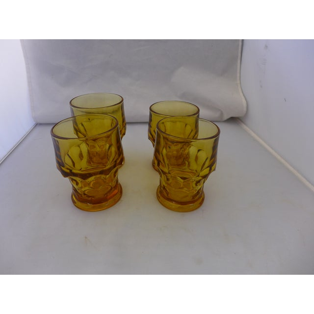 Set of four (4) Mid-Century Modern glasses. Features a lovely honeycomb amber hue. Great as water or bar heavy glasses....