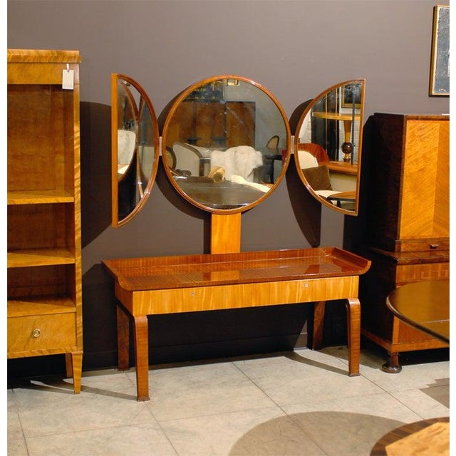 Silver screen-worthy dressing table from 1930's Sweden. Crafted of ribbon stripe mahogany and rare blonde prima vera white...