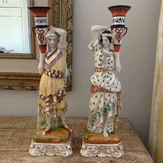 Antique European Porcelain Eastern Figural Candleholders Preview