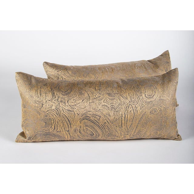 """This gold swirl pattern lumbar pillow measures 12""""x24"""". The iridescent gold pattern shimmers in the sunshine making it the..."""