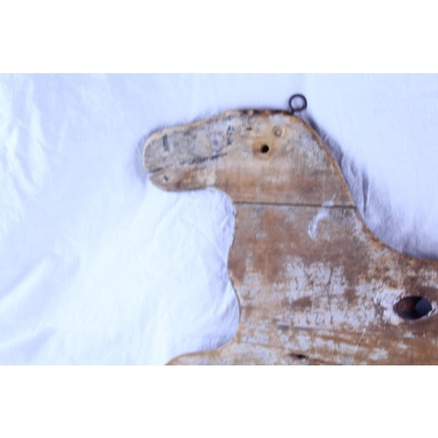 Antique folk art horse made of wood with two hooks for hanging. Hand painted.