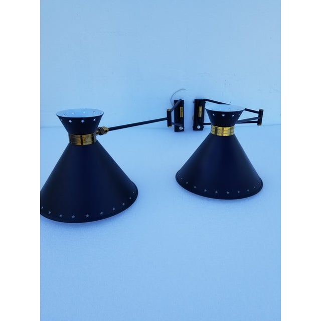 Pair Of Lunel Rétractable Sconces, restored and US Rewired In very good Vintage Condition. Dimensions totally open: 28...