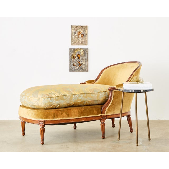 Gorgeous French mahogany chaise longue daybed made in the Louis XVI taste. The frame features a gracefully curved back...