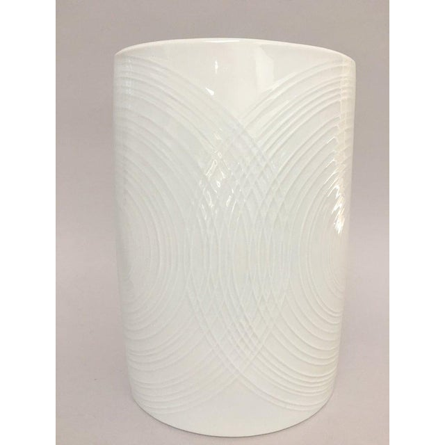 Large white porcelain vase from Naaman Israel in a flattened oval pillow shape ca. 1980s. The vase features a shiny white...