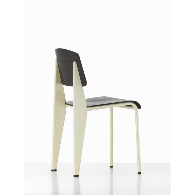 Jean Prouvé Standard chair in dark oak and white metal for Vitra. The Standard chair is an early masterpiece by the French...